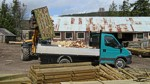 Loading wood into van